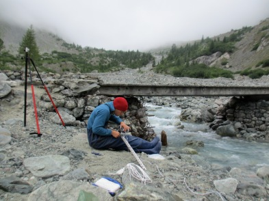 Installing instruments on the Proglacial stream of Glacier Noir, Southeast France, 2014.